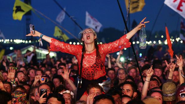 The crowd watching Florence + The Machine performing on the Pyramid Stage