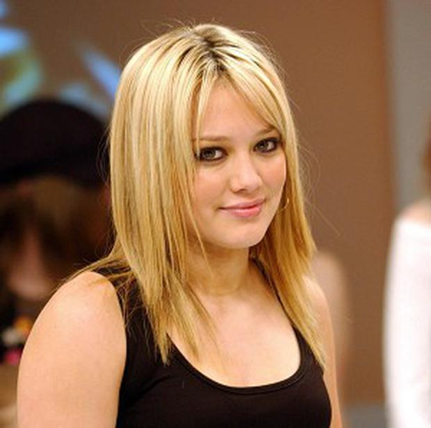 Hilary Duff is staying close to Mike Comrie after their split