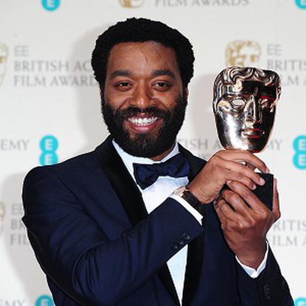 Chiwetel Ejiofor with the Best Actor award for 12 Years A Slave