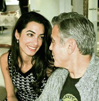 Hollywood star George Clooney and his fiancee, British human rights lawyer Amal Alamuddin