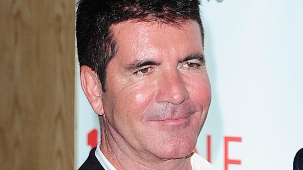Simon Cowell is enjoying being a dad