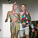 Miley Cyrus struts her stuff with designer Jeremy Scott at New York Fashion Week