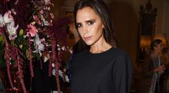 Victoria Beckham wore one of her own designs at London Fashion Week (Richard Young/Rex)