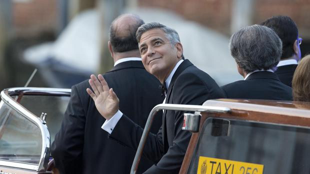 George Clooney on his way to the ceremony (AP)