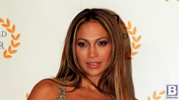 A car carrying singer Jennifer Lopez and actress Leah Remini was hit by a suspected drink-driver