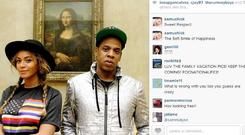 Beyonce and Jay Z pose with the Mona Lisa (Jay Z/Instagram)