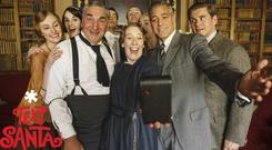 George Clooney poses for a selfie with his Downton Abbey co-stars