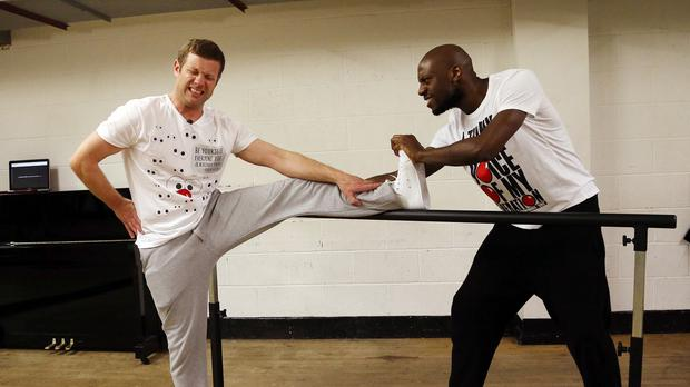Dermot O'Leary getting stretched by professional dancer Shaun, who plans to teach him routines to keep him going throughout his 24-hour dance challenge for Comic Relief