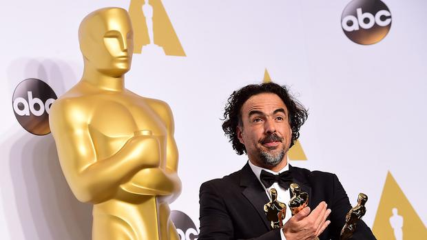 Alejandro Inarritu with his haul of Oscars for Birdman (AP)