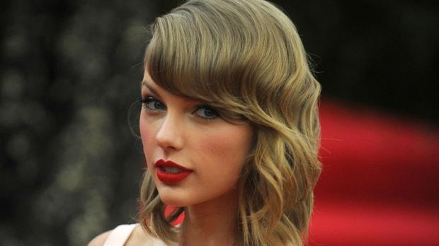 Taylor Swift received her award from Sam Smith