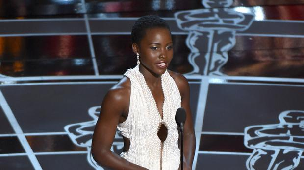Actress Lupita Nyong'o wore a pearl dress as she presented an award at the Oscars (AP)