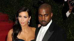 Kanye West, pictured with wife Kim Kardashian, will perform on the Pyramid Stage on the Saturday night