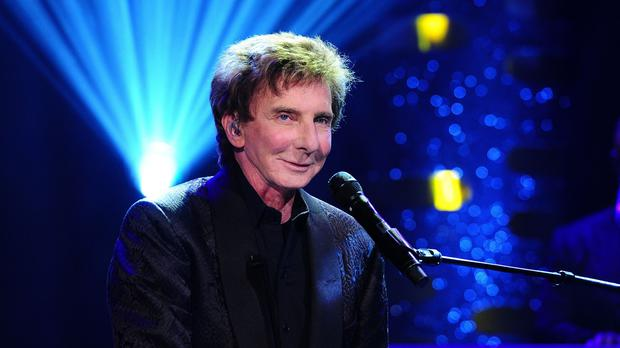 Barry Manilow has secretly married his manager, according to a magazine