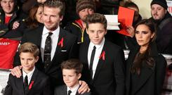 Brooklyn Beckham with his family