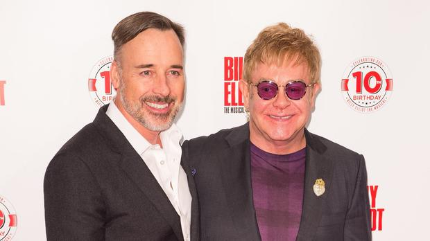 Sir Elton John, right, urged the new Government to 'be compassionate'