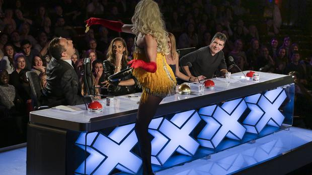 Russella feeds pancake to judge David Walliams during the audition stage of Britain's Got Talent (ITV/PA)