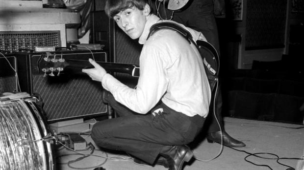 George Harrison played the guitar in the summer of 1963