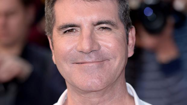 Simon Cowell said he doesn't worry about whether to sack Louis Walsh