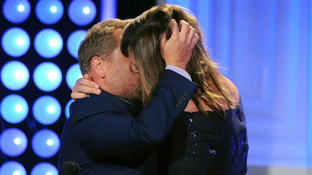 James Corden kisses Allison Janney as he presents her award (AP)