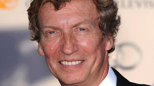 Nigel Lythgoe said collecting his OBE will be a proud moment