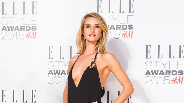 Rosie Huntington-Whiteley says she is happier in her wellies than on the red carpet