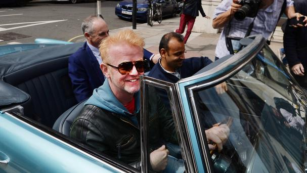 Chris Evans leaves the BBC Radio studios in London, in his vintage Aston Martin, after he was announced as the new Top Gear presenter