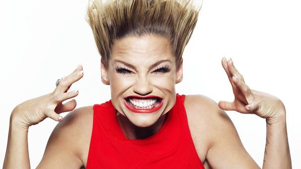 Former Girls Aloud singer Sarah Harding, 33, showing no airs and graces as her face is battered with a 270mph blast of wind blown in the world's first high speed selfie photo booth.