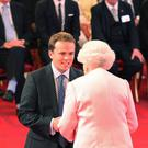 Edmund Page was one of three Britons named a Queen's Young Leader for his work educating refugees in Uganda and Keny