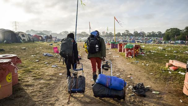 Festival goers leave the Glastonbury Festival