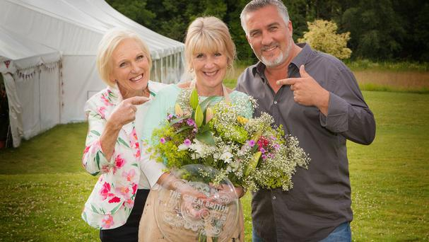 Great British Bake Off judges Mary Berry and Paul Hollywood with 2014 winner Nancy Birtwhistle