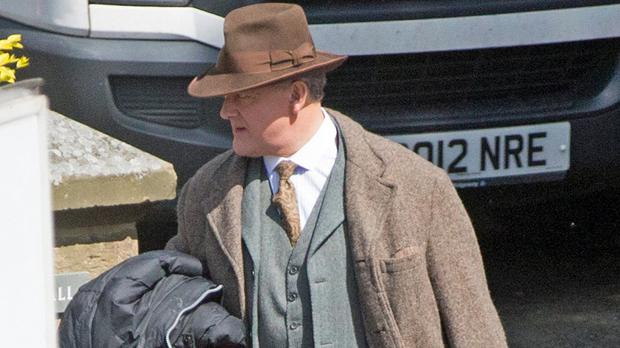 Hugh Bonneville dressed in period costume on set in Alnwick, Northumberland