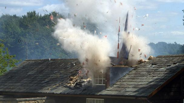 A helicopter crashes into Emmerdale Village Hall. (PA/ITV)