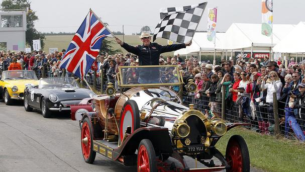 Chris Evans inside his 1936 Chitty Chitty Bang Bang replica which is among those he is putting up for auction