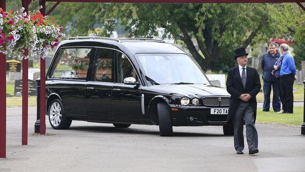 The hearse carrying the coffin of George Cole arrives at Reading Crematorium for his funeral