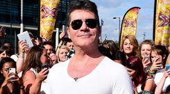 Simon Cowell has given his X Factor show a shake-up (Ian West/PA Wire)