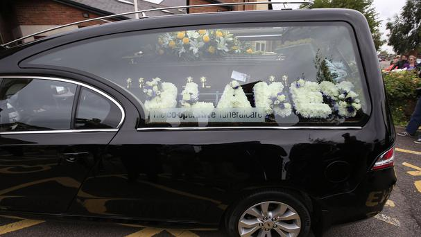A hearse carrying the coffin of actor Stephen Lewis, known for his role as Inspector Cyril