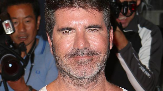 Simon Cowell attending the X Factor Media Launch held at Playhouse Central on Shaftesbury Avenue, London