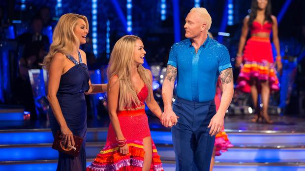 Ola Jordan, centre, suffered a wardrobe malfunction when she was introduced by host Tess Daly, left, alongside her dance partner Iwan Thomas (Guy Levy/BBC)