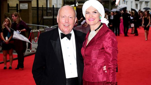 Julian Fellowes and his wife Emma Joy Kitchener (Ian West/PA Wire)