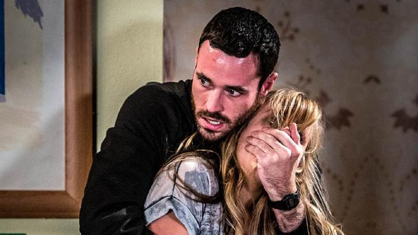 Sean Ward and Tina O'Brien rehearsing thrilling fight scenes which will be aired in the first part of the Coronation Street Live episode. (ITV)