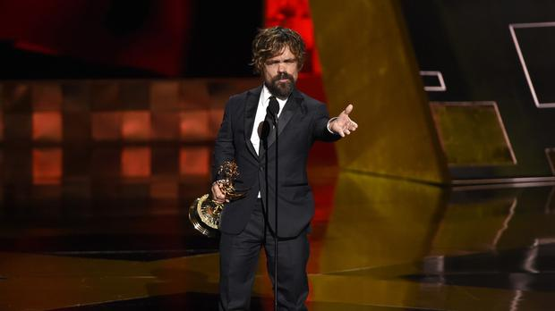 Peter Dinklage accepts the award for outstanding supporting actor in a drama series for Game Of Thrones (AP)