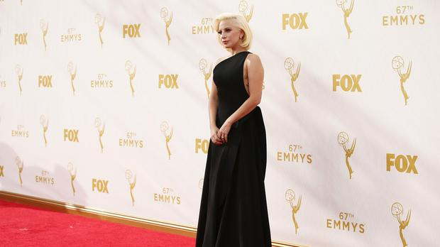 Lady Gaga opted for an elegant, full-length black gown from designer Brandon Maxwell (AP)