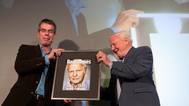 Radio Times editor Ben Preston (left) presents Sir David Attenborough with his induction into the Radio Times' inaugural Hall of Fame