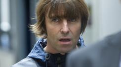 Liam Gallagher has apologised for sending a homophobic tweet