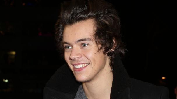 One Direction's Harry Styles topped a study to find the happiest celebrity on Twitter