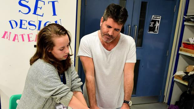 Simon Cowell visits The Brit School and the Nordoff Robbins facility in London