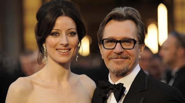 Gary Oldman and Alexandra Edenborough, pictured at the Oscars in 2012, have finalised their divorce (AP)