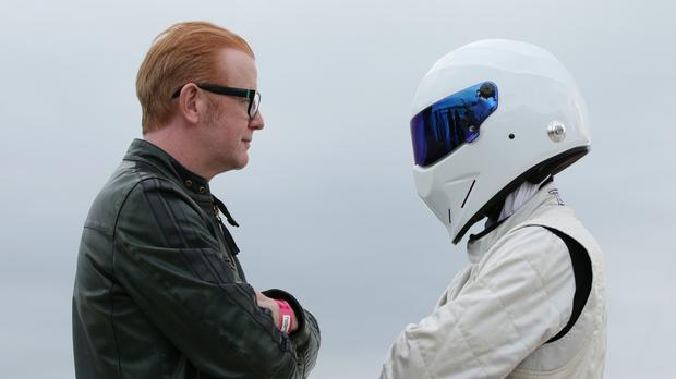 New Top Gear host Chris Evans squares up to the Stig as he hints that there may not be co-hosts with him at all times