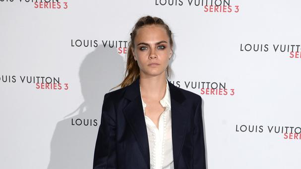 Cara Delevingne arriving at the Louis Vuitton Series 3 exhibition opening gala in The Strand, central London.