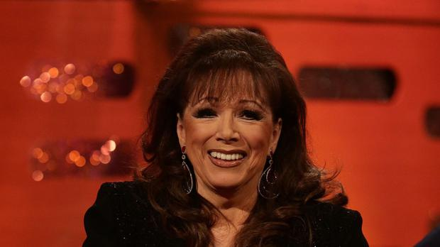The daughters of the best-selling romance novelist Jackie Collins said they felt their mother was with them as they collected an award on her behalf just five weeks after her death